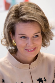 Queen Mathilde of Belgium kept it ladylike with this bob while visiting Lokeren.