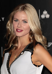Donna Air attended the Quintessentially Awards with her long tresses in soft waves. Try her look by curling random three-inch sections with a large-barreled curling and then tousling waves with fingers.