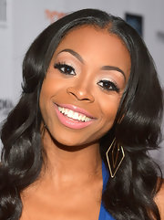 A light cotton candy pink lipstick softened up Bresha's beauty look.
