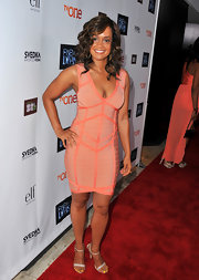 Tammy Townsend showed off her killer curves with a pink and peach bandaged dress.