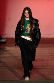 Kaia Gerber looked tough in a bulky black leather jacket while walking the R13 show.