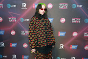 Billie Eilish attended the We Can Survive event wearing a bulky zip-up jacket by Gucci.