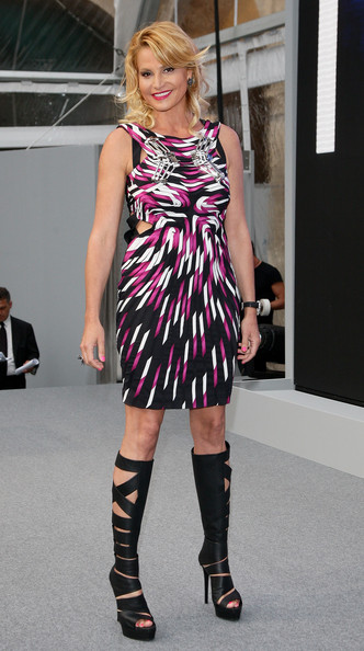Simona Ventura completed her rocker-chic look with black knee-high cutout boots.