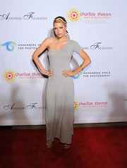Sophie Monk donned a one-shoulder heather gray maxi-dress for the Charlize Theron Africa Outreach benefit.