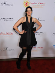 Sarah Silverman is famous for her quirky sense of style. The funny gal donned a black strapless dress with a long draped scarf for the Charlize Theron Africa Outreach benefit.