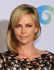 Charlize Theron accentuated her eyes with bronze and copper eyeshadow at an event benefitting the Africa Outreach Project.