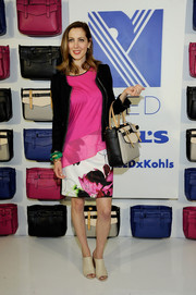 Eva Amurri Martino paired a fuchsia asymmetrical-hem blouse with a black tweed jacket for the Reed x Kohl's Collection launch.