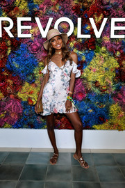 Jasmine Tookes paired her dress with strappy slide sandals.