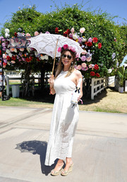 Carly Steel looked like the goddess of spring with this white lace maxi dress and flower headband combo at the Revolve Desert House party.