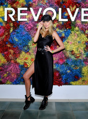 Elsa Hosk flaunted some leg in a high-slit black slip dress by LPA at the Revolve Desert House party during Coachella.