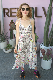 Kiernan Shipka's colorful sneakers and flowy dress made a quirky pairing.