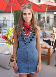 Chiara Ferragni jazzed up her denim dress with an embellished red scarf for the Revolve Welcome to the Desert event.