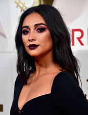 Shay Mitchell went for a super-edgy beauty look with a smoky application of purple eyeshadow.