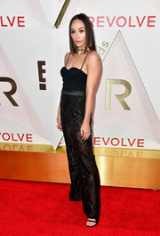 Cara Santana went the sultry route in a black corset bodysuit at the #REVOLVEawards.