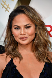 Chrissy Teigen looked gorgeous with her windswept waves at the #REVOLVEawards.