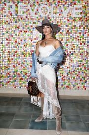 Olivia Culpo contrasted her delicate frock with an edgy denim jacket by Grlfrnd.