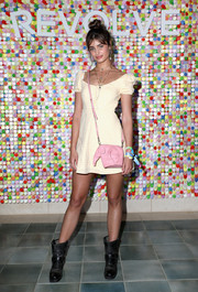 Taylor Hill topped off her look with an adorable pink elephant bag by Loewe.