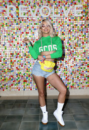 Jasmine Sanders struck a pose at #REVOLVEfestival wearing a cropped green hoodie.