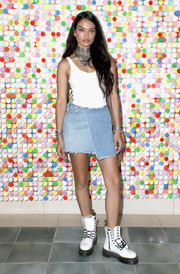 For her footwear, Shanina Shaik went edgy with a pair of chunky white combat boots.