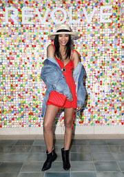 Chanel Iman topped off her dress with an oversized denim jacket.