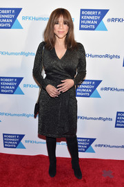 Rosie Perez styled her classic frock with black knee-high boots.