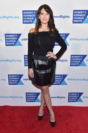 Hilaria Baldwin completed her edgy-sexy outfit with a black leather mini skirt.