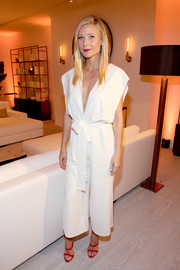 Red hot heels added a pop of color to Gwyneth Paltrow's polished outfit.
