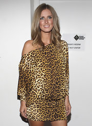 Nicky Hilton showed off her shoulder length center part layers while attending the Charlie Brown fashion show.
