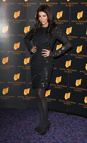 Shobna Gulati worked the red carpet in this long-sleeved black dress with beaded embellishments.