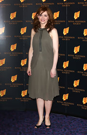 Anne-Marie Duff opted for an olive-colored draped dress for her red carpet look at the RTS Programme Awards in London.