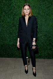 Black Jimmy Choo pumps with gold ankle straps polished off Olivia Palermo's outfit.