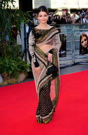 Aishwarya looked stunning in an intricately detailed sari-style evening dress.