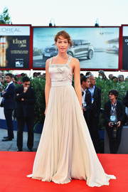 Cristiana Capotondi worked the red carpet in a pale gray gown with an embellished bodice and an open back at the Venice Film Fest premiere of 'Rabin, The Last Day.'
