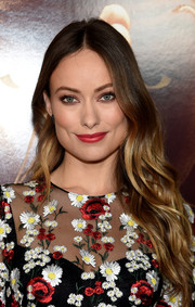 Olivia Wilde amped up the girly appeal with red lipstick.