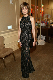 Lisa Rinna flaunted her ageless figure in a black lace halter gown at the Race to Erase MS Gala.