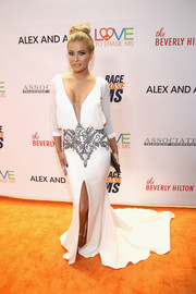 Carmen Electra caught admiring stares in a plunging white fishtail gown at the Race to Erase MS Gala.