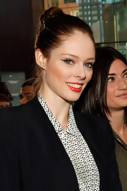 Coco Rocha wore her sleek copper tresses in a high classic bun at the Rachel Roy fall 2012 fashion show.