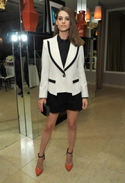 Lyndsy Fonseca chose a black-and-white short suit by Rachel Zoe for the relaunch of 'The Zoe Report.'