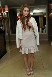 Holland Roden finished off her neutral ensemble with a pair of nude cross-strap platform sandals.