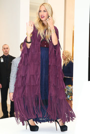 Rachel Zoe was hippie-glam in a fringed purple suede cape by Burberry during her 'Living in Style' book signing.