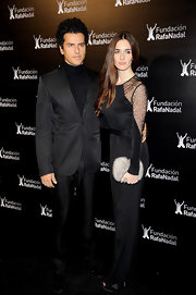 Paz Vega added glamour to her lacy black dress with a furry clutch.