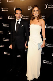 Paloma goes winter white in a strapless gown.