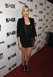 Charlize Theron rocked the red carpet at the Rage premiere in LA in an all-black ensemble. She paired the look with gold platform sandals, complete with gold hardware and zippered detailing.