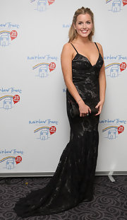 Caggie Dunlop arrived at the Rainbow Trust ball wearing a floor-length lacy dress with a plunging neckline.