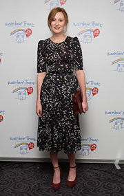 Laura Carmichael combined vintage and glam as she opted for a black print dress at the Rainbow Trust Ball.