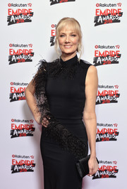 Joely Richardson paired a black satin clutch with a feather-adorned frock for the Rakuten TV Empire Awards 2018.