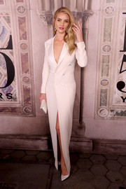 Rosie Huntington-Whiteley matched her frock with a white satin clutch by Tyler Ellis.