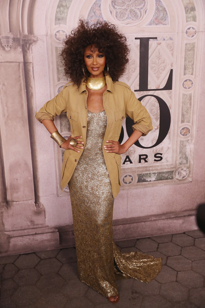 Iman looked downright fab in a gold sequined gown at the Ralph Lauren fashion show.