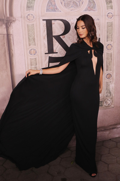 Lily Aldridge worked a caped black column dress with a navel-grazing neckline at the Ralph Lauren fashion show.