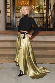 A flowing gold skirt (also by Ralph Lauren) added major glamour to Annabelle Wallis' look.